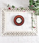 Unravel India Multicolor Wooden Embossed Painting Wall Clock for Rs. 1,103 @ Pepperfry